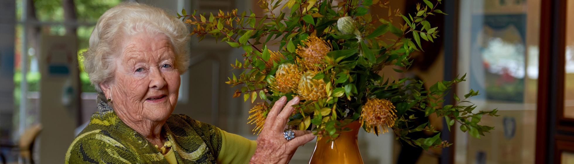 Volunteer arranging flowers