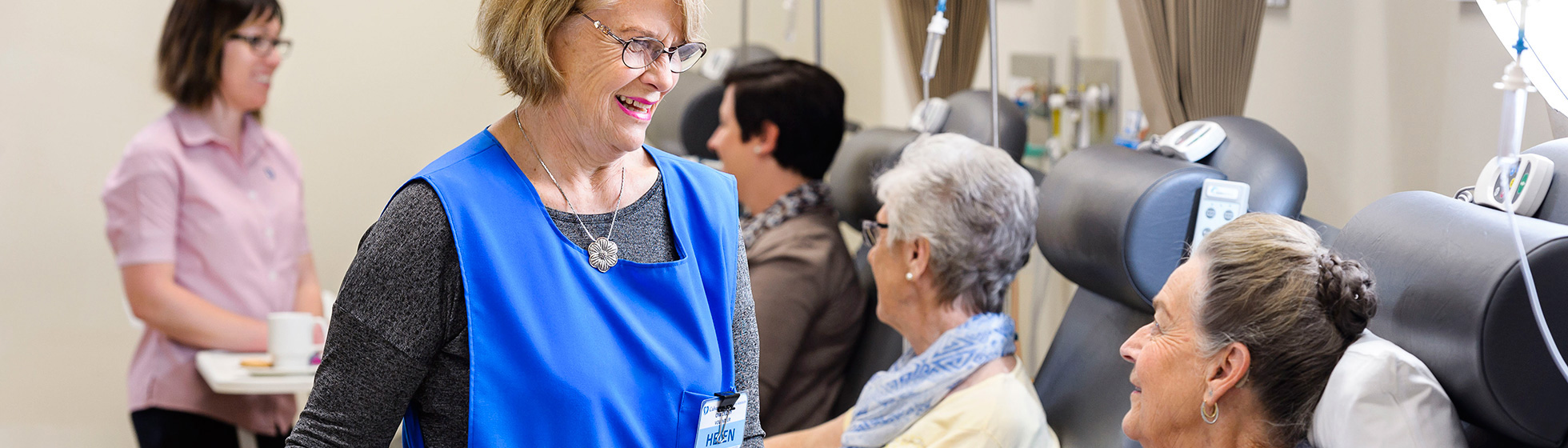 Volunteer caring for cancer patient