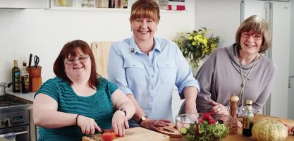 care worker helping with dinner preparation