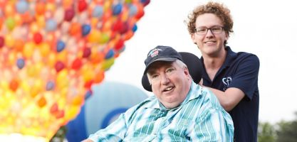 calvary support worker takes disability client to hot air balloon festival