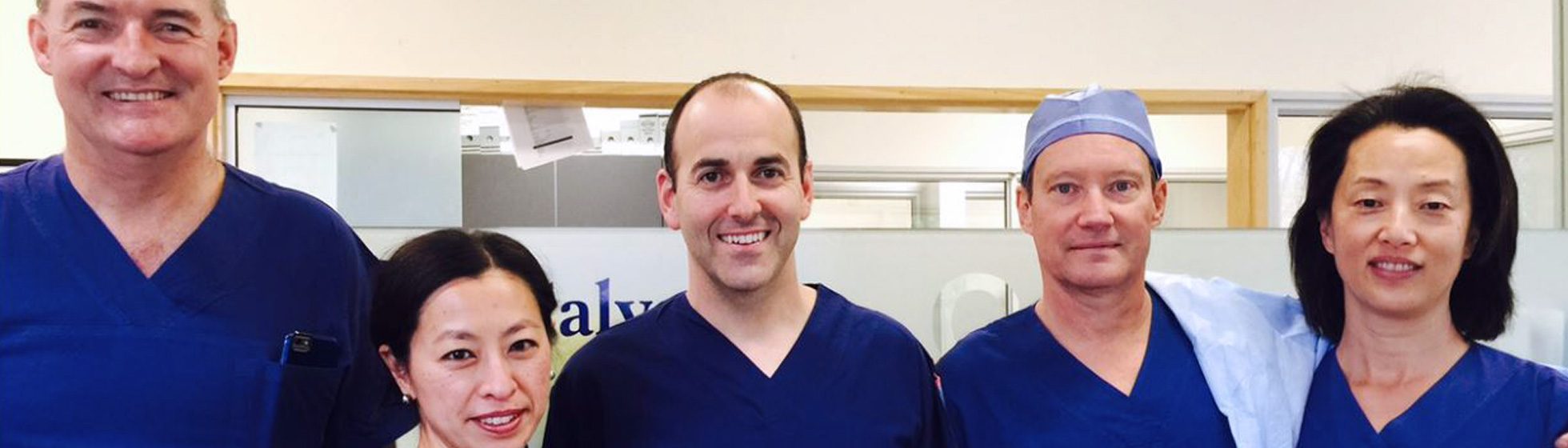 Surgeons and medical specialists in scrubs