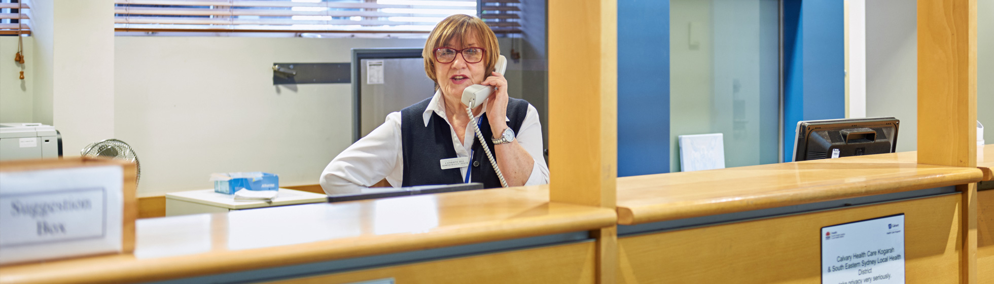 Receptionist speaking on the phone