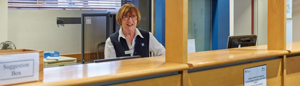 Receptionist at admissions front desk