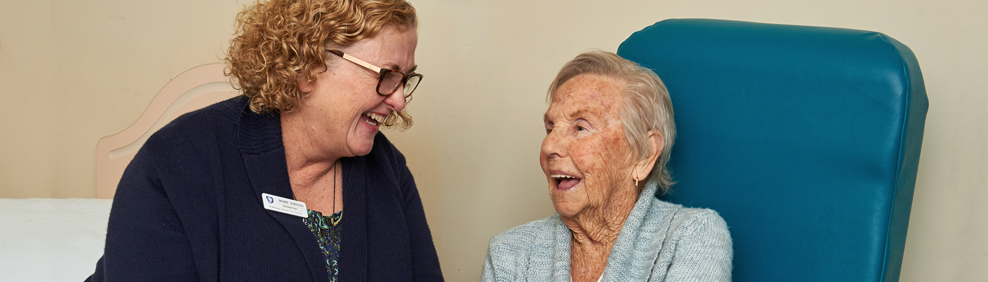 Pastoral care worker with palliative patient
