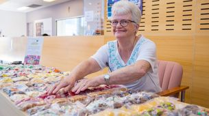 Auxiliary volunteers raise money for cancer on lolly table