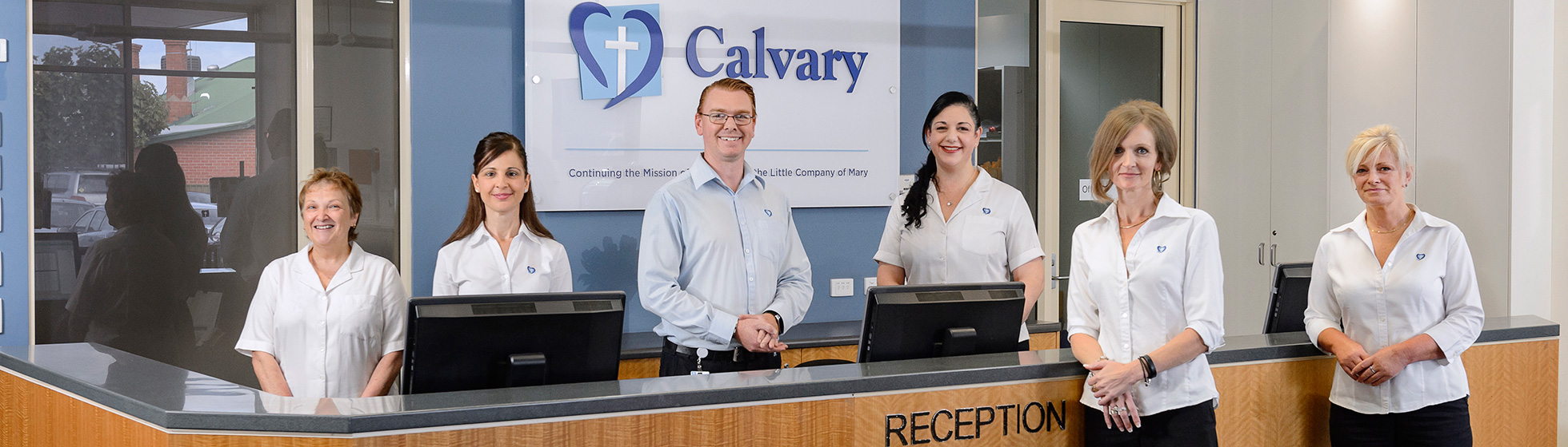 Friendly receptionists at Rehab front desk