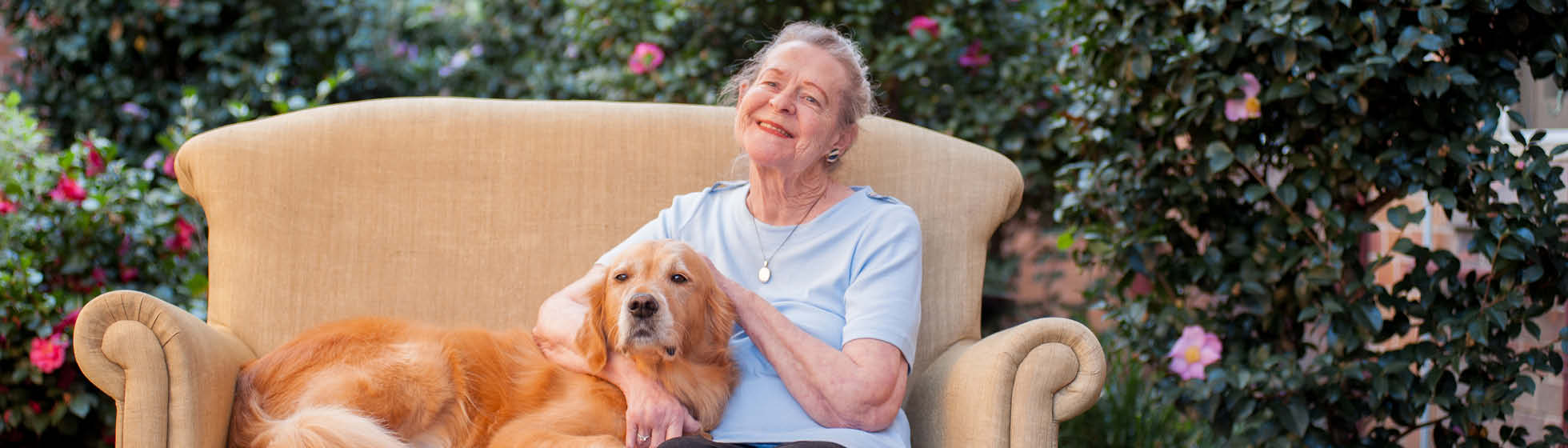 resident enjoying pets as therapy dog