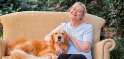Resident enjoys dogs company at nursing home