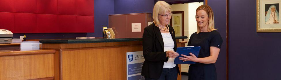 Completing admission details at front desk of Riverina Hospital