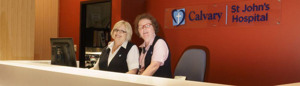 Receptionists at hospital admission desk