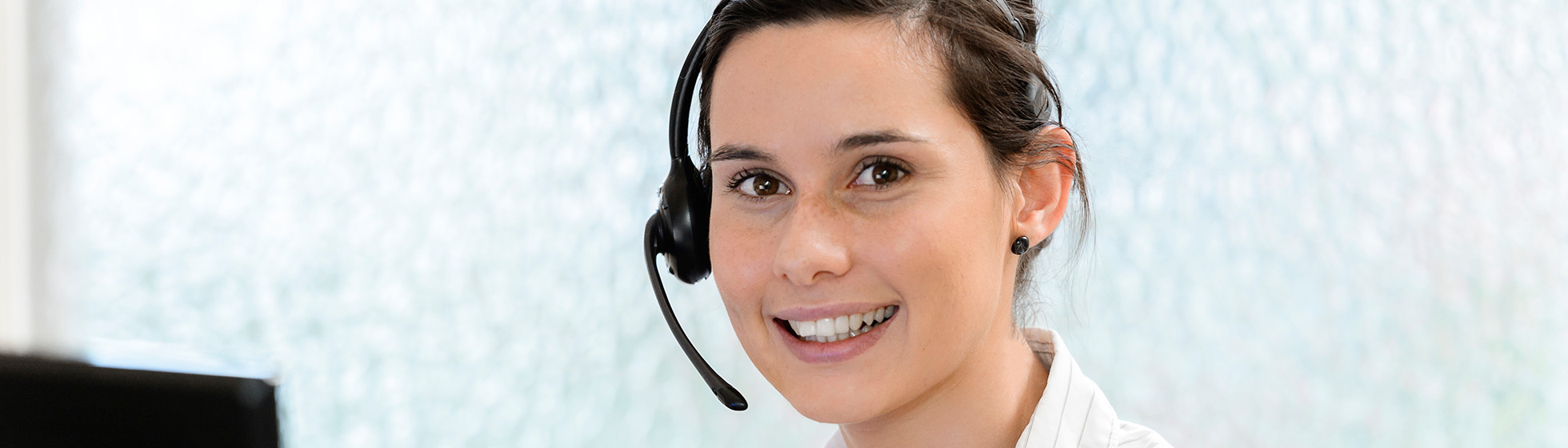 Receptionist at front desk of Wakefield Hospital
