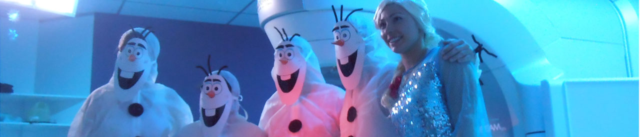 Cancer department dress up as Elsa Olaf from Frozen for cancer patient