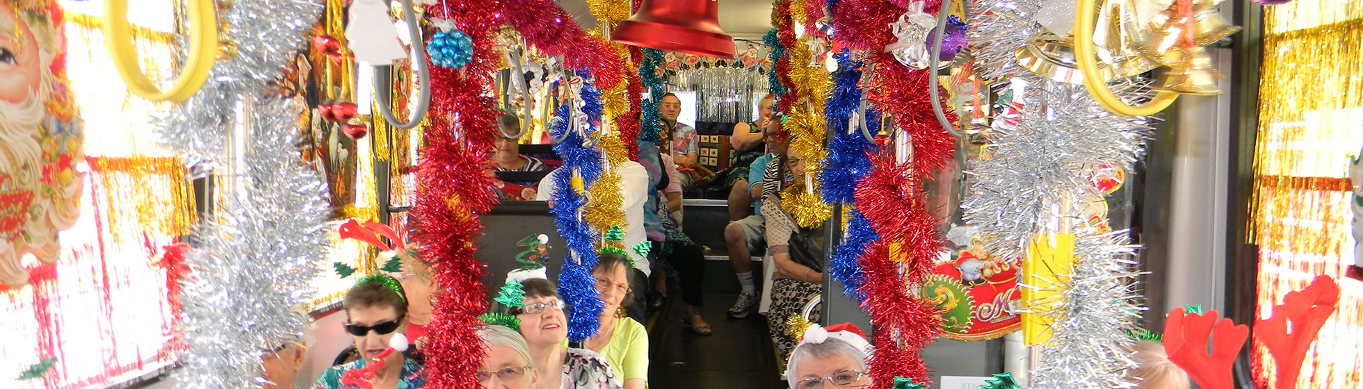 Travellers enjoying the decorated Christmas Bus